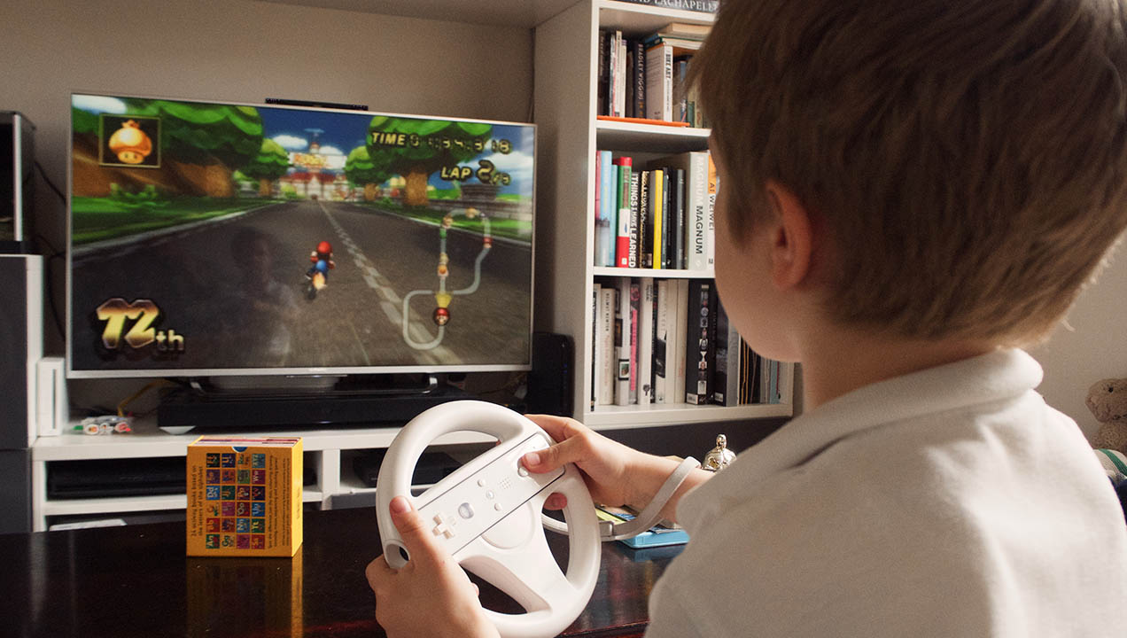 Child plays Wii racing game