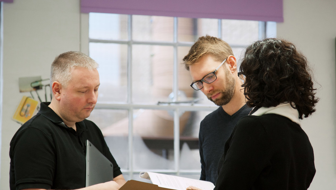 Mark in discussion with colleagues