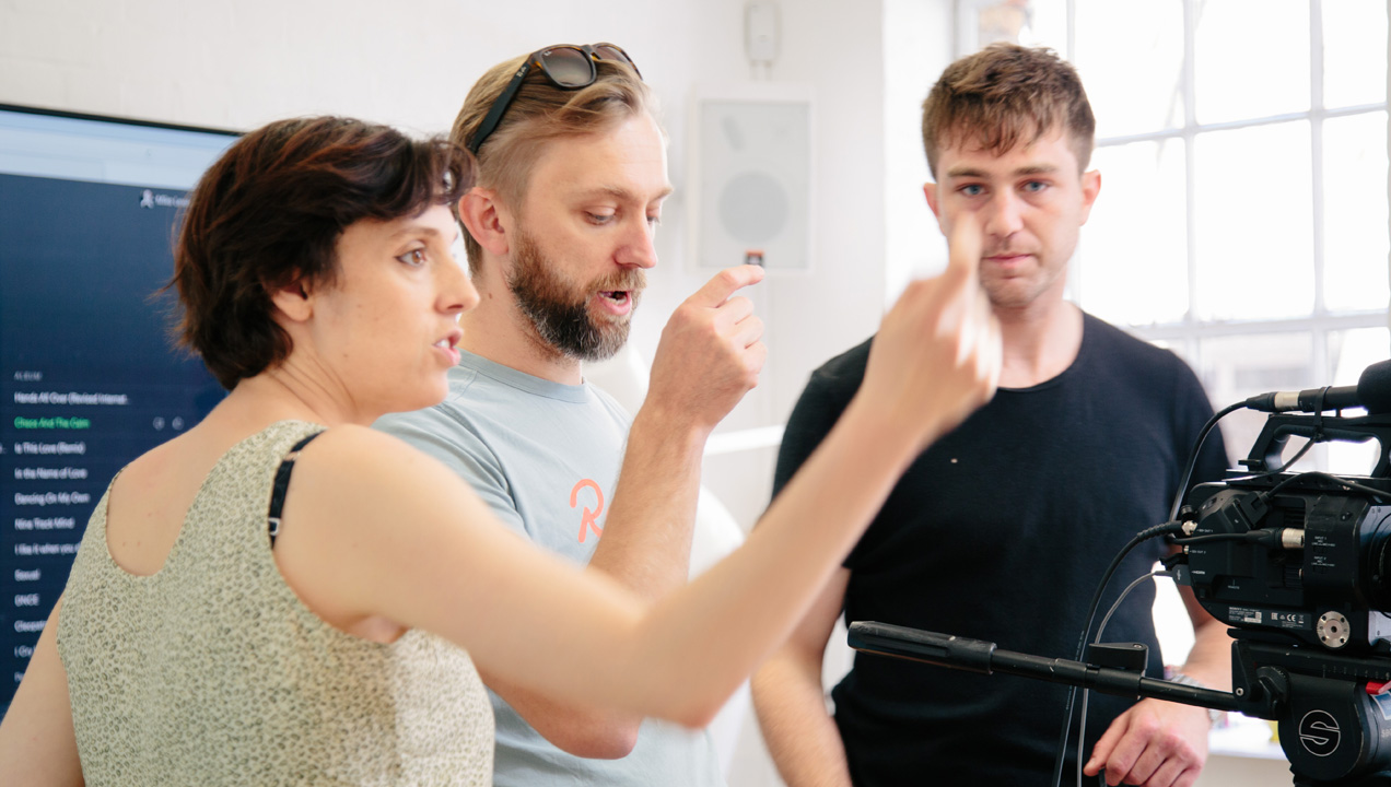 Anton discussing with colleagues during filming