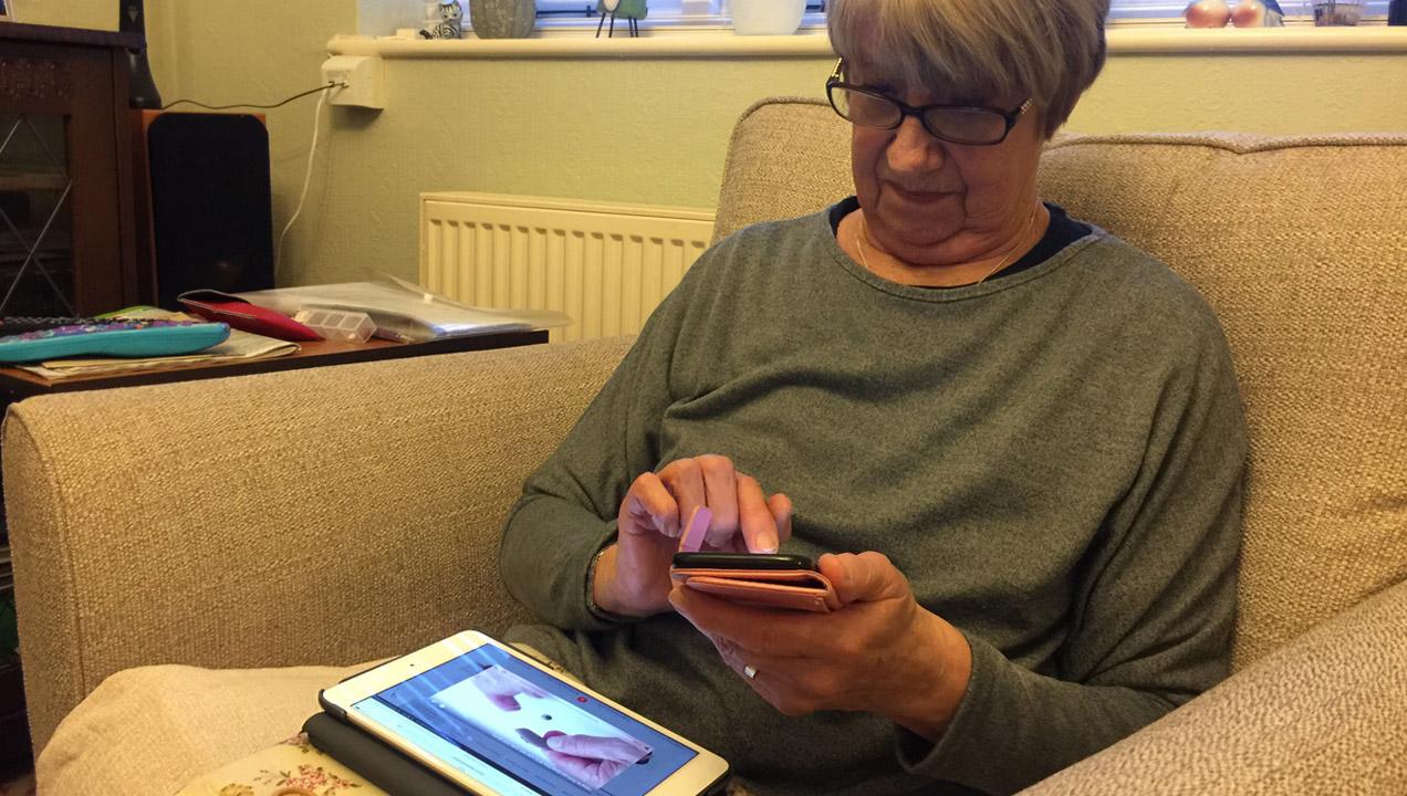An older lady using an iPad