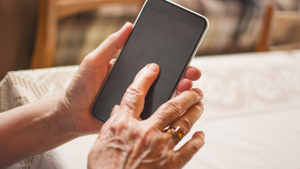 An older lady using a smartphone
