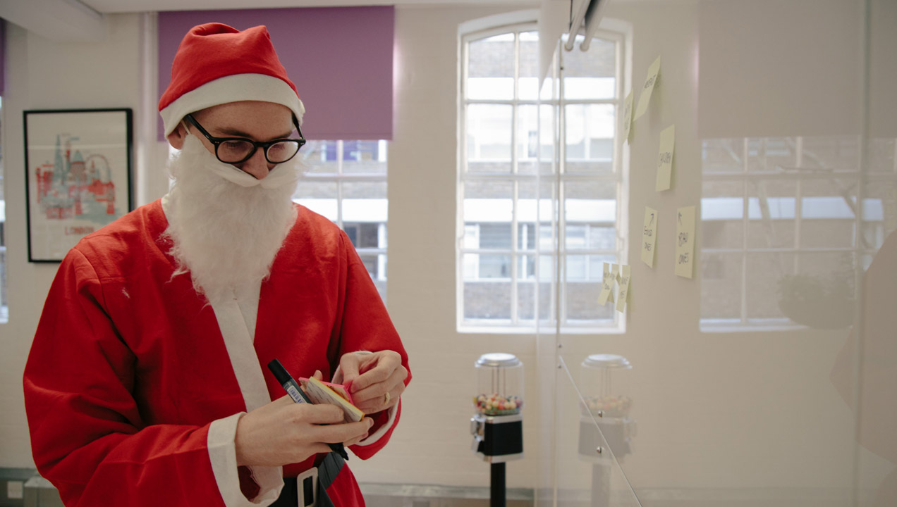 Simon from our office wearing a Santa costume and brainstorming