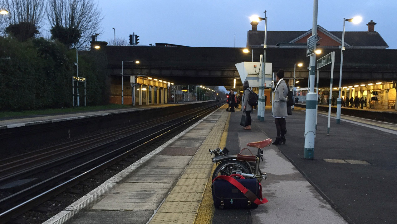 Anton waiting at the station with his Brompton