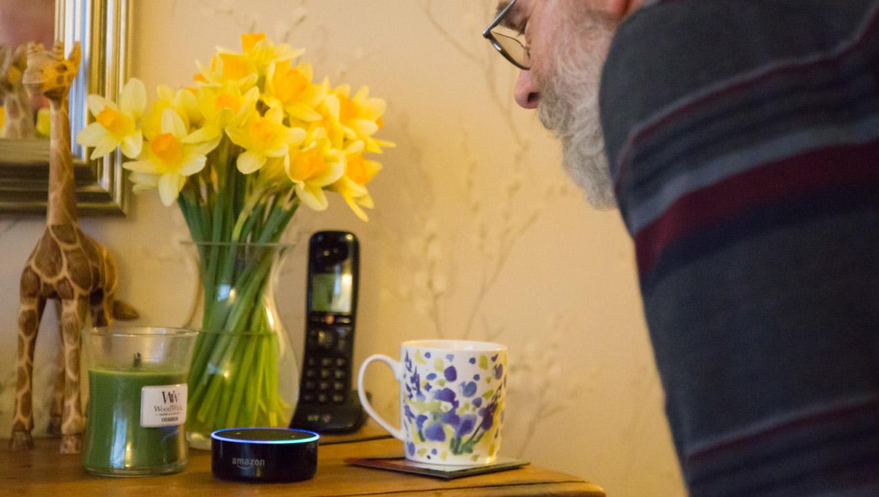 Man speaking to an Amazon Echo