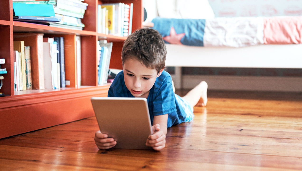 Young boy using iPad