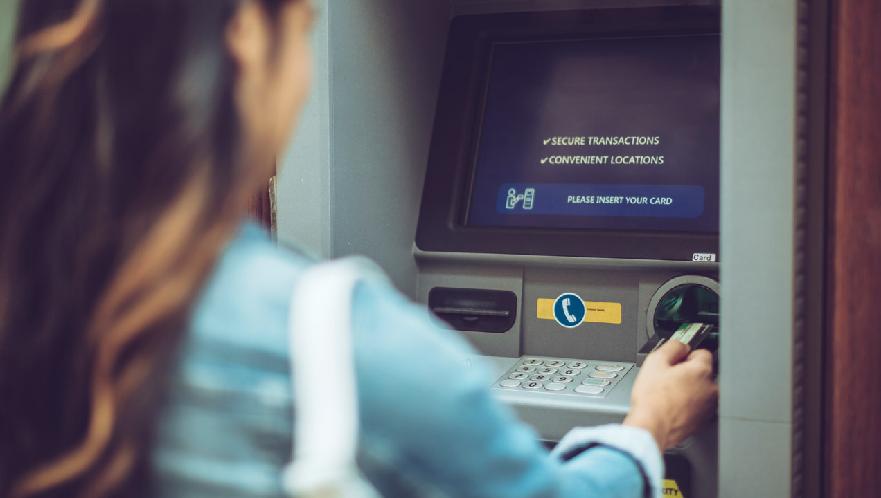 A woman using a ATM