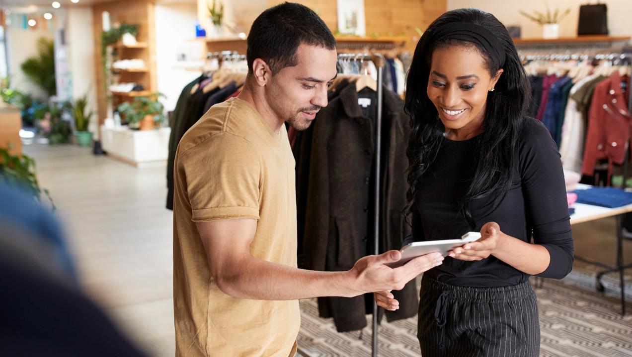 A staff member helping a customer
